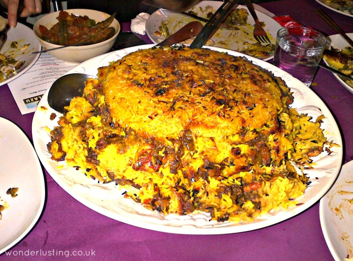 Maygoo Polow: Spicy shrimp rice with raisins and tadig (the crunchy rice layer)