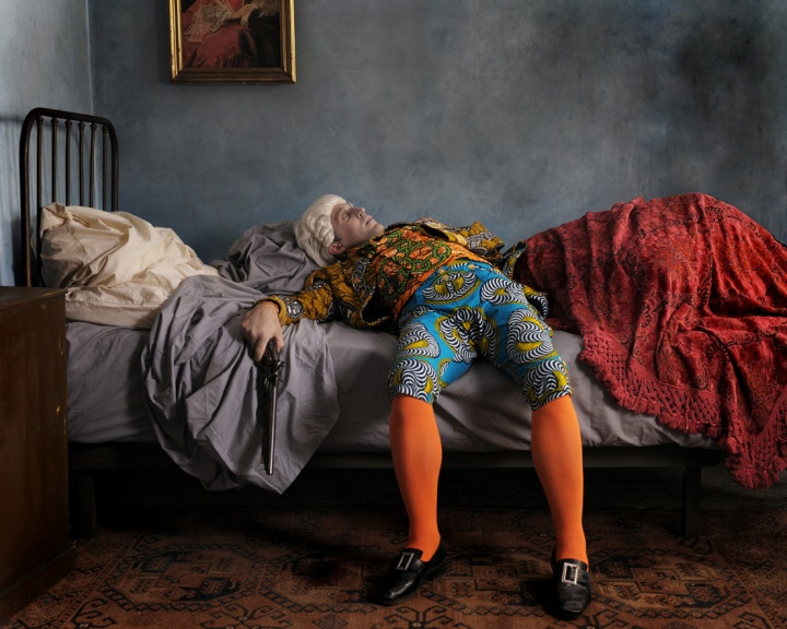ake Death Picture, Yinka Shonibare MBE. One of the digital paintings on display. The outfit Nelson is wearing is a replica of his Trafalgar uniform minus the bullet hole