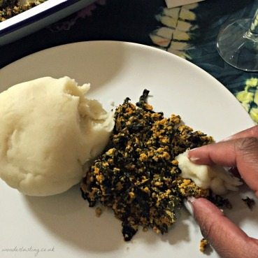 Eating pounded yam the traditional way at Tokunbo's Kitchen