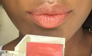 Kjaer Weis lip tint in 'Passionate'