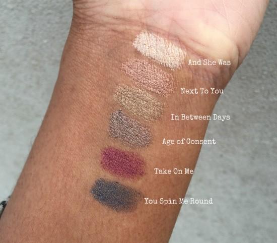 swatches of ILIA silken shadow sticks on dark skin