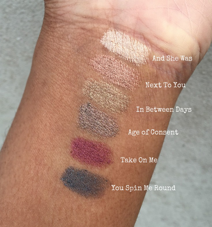 swatches of ILIA silken shadow sticks on dark skin