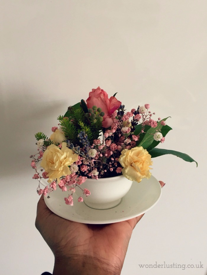 flowers in a teacup and saucer