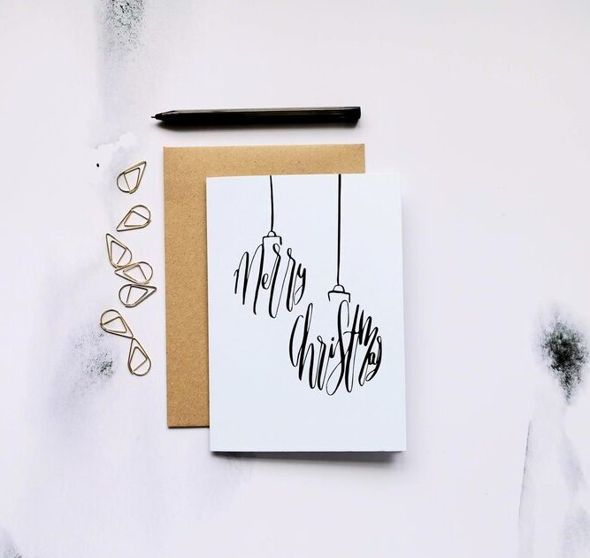 calligraphy christmas bauble illustration on card
