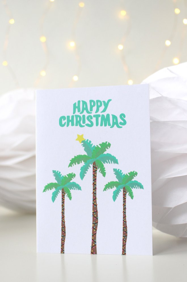 christmas card with palm trees in a globe by Tihara Smith